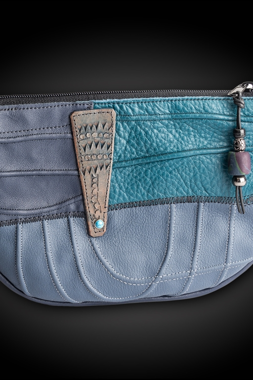 Faye Fisher-Ward - Booth 3 2016 Award of Merit Inspired by tribal and ancient art I employ both vegetable and chrome tan leathers to create useable works of art in the form of bags and related accessories.
