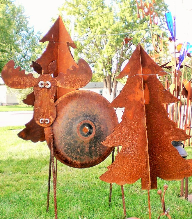 Mary Felden - Booth 99 & 100 I create garden art from metal, rocks, glass, and re-purposed items.