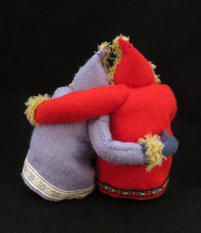 "Betsey Harries - Booth 51 I design 6"" high art dolls that wear colorful parkas, snow pants, & mukluks. I hand-sew the outfits from wool felt, make the faces of clay, and braid their hair from buffalo, sheep, & alpaca fibers."