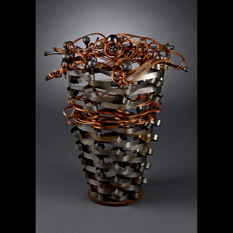 Demetra Saloutos - Booth 75 Hand forged copper bird bathes,garden topiary's plant stands,and trellis's All hand woven by hand with bands of steel and accented with copper.