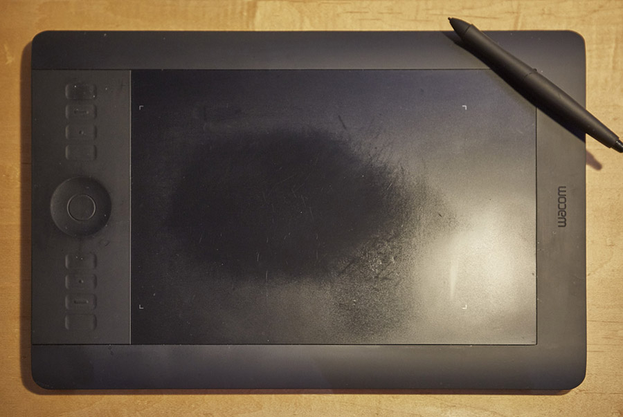 This first gen Intuos Pro showing some signs of use and love. The smoothed shiny surface the result of heavy use.
