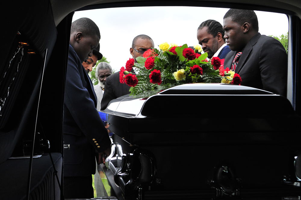 Mourners lifted the coffin of Bobby Clark from a hearse at his graveside Friday April 13, 2012 in Tulsa, Oklahoma. Mr. Clark was a victim of the shootings that Jacob C. England and Alvin Watts are accused of committing. Nick Oxford for The New York Times