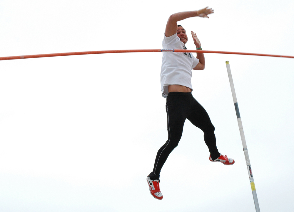 Julian Rodriguez cringes as he knocks off the bar while competing in the pole vault competition at the Bison Track Invitational in Shawnee Oklahoma March 26, 2011.