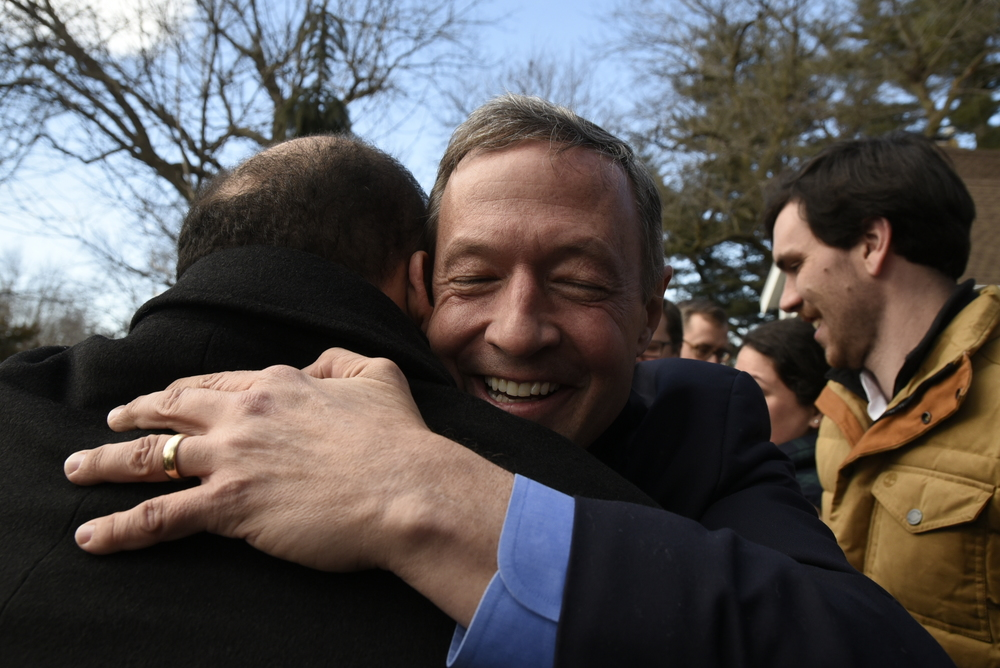 Democrat presidential candidate Martin O'Malley embraces a supporter at a door knocking event the day before the Iowa Caucuses in Des Moines Iowa.