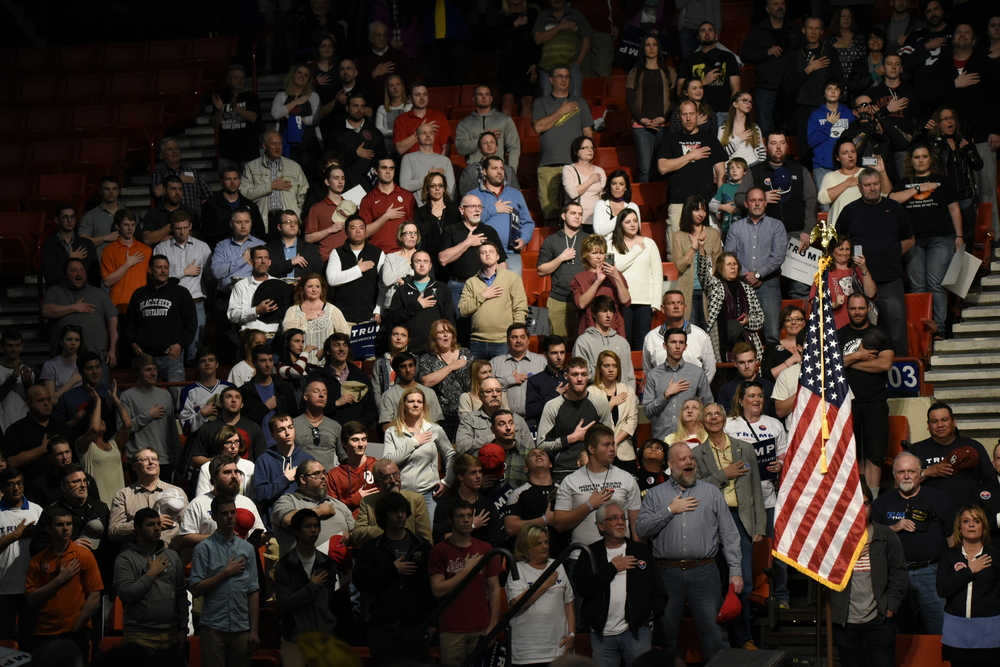 Supporters recite the Pledge of Allegiance at a rally for Republican U.S. presidential candidate Donald Trump in Oklahoma City, Oklahoma February 26, 2016. REUTERS/Nick Oxford