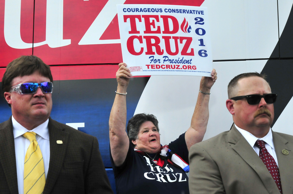 Maggie Wright waves a sign in support of republican presidential candidate Senator Ted Cruz at a rally in Oklahoma City, Oklahoma August 13, 2015.