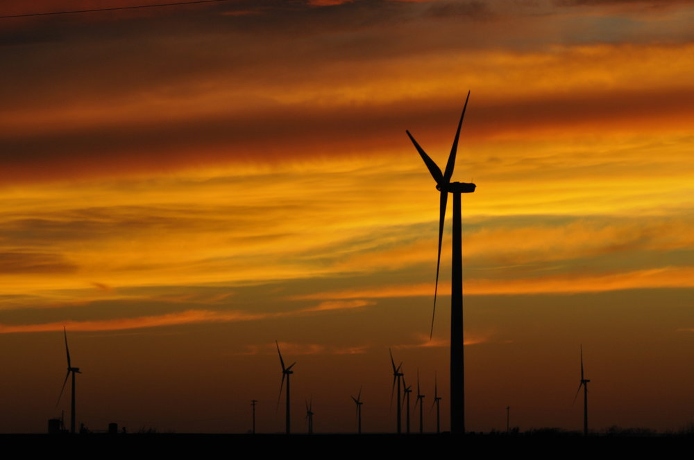 A large wind farm at sunset in Seiling, Oklahoma.