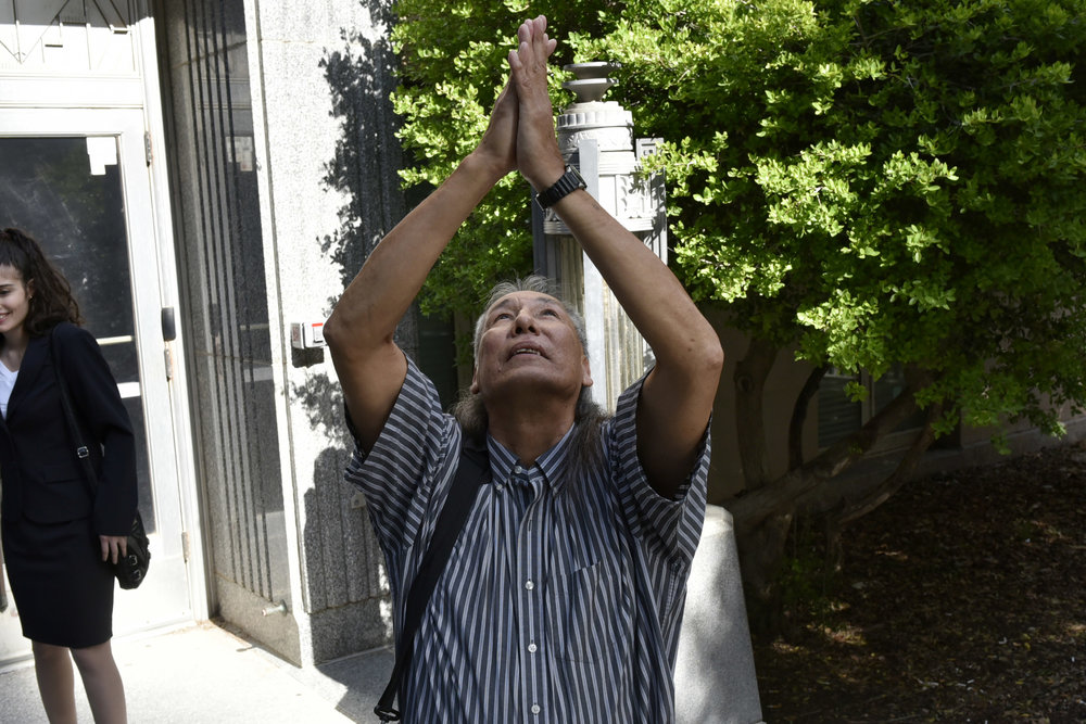 Johnny Tallbear thanks god as he takes his first steps as a free man after 26 years in prison for a murder he didn't commit. Johnny was with help from DNA that proved his innocence.  Nick Oxford for The Innocence Project