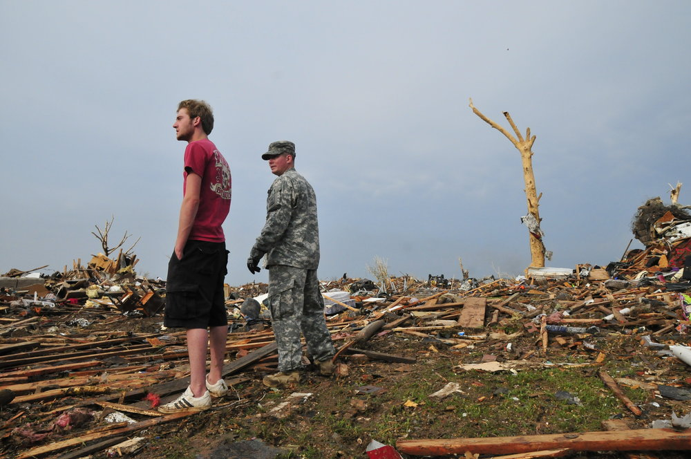 A National Guardsmen and resident in a neighborhood destroyed by the tornado on May, 20 in Moore Oklahoma