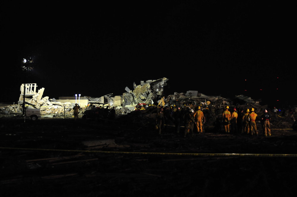 Rescue workers search what remains of Plaza Towers Elementary after a tornado ripped through Moore on May, 20 in Moore Oklahoma