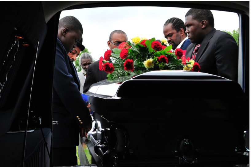 Pallbearers lift the coffin of Bobby Clark, who was shot and killed in North Tulsa on Good Friday, out of the hearse at his funeral. Nick Oxford for The New York Times