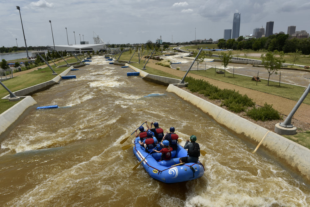 A group traverses the rapids at a $45.2 million Whitewater Rafting & Kayaking Center that was paid for by a 1-cent sales tax increase in Oklahoma City on July 14, 2018. (Photo by Nick Oxford for The Washington Post)