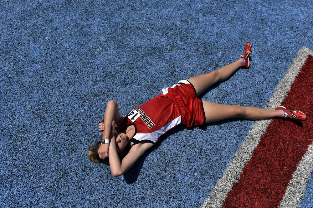 Kennedy Kiesau, a freshman at Carnegie High School, takes a break after running in the 800 meter race during the Class A and 2A track championships at Western Heights High School, Saturday, May 5, 2018. Photo by Nick Oxford for The Oklahoman