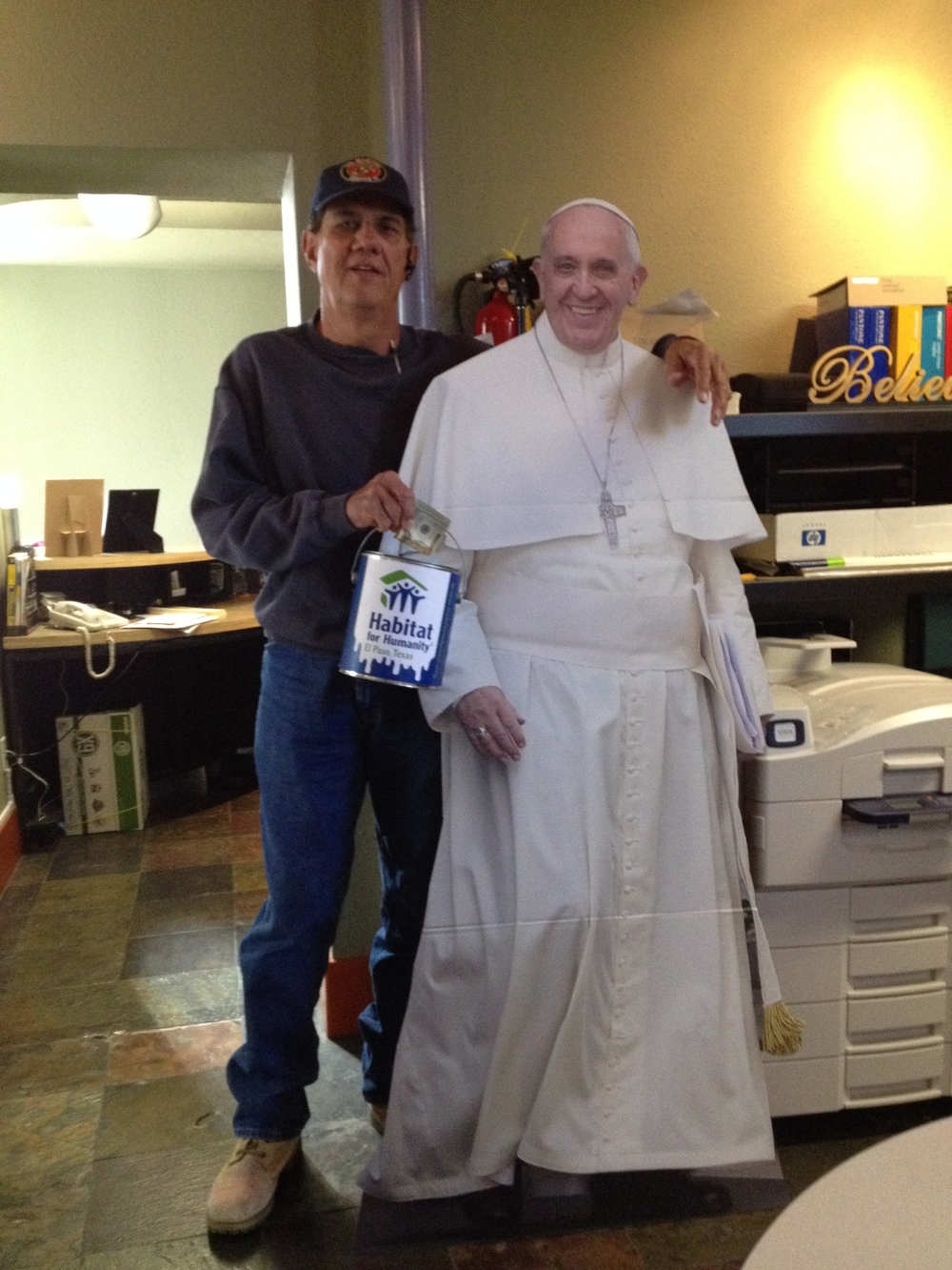 Construction Supervisor Ignacio Alarcon encouraging match donations to the Pope House.