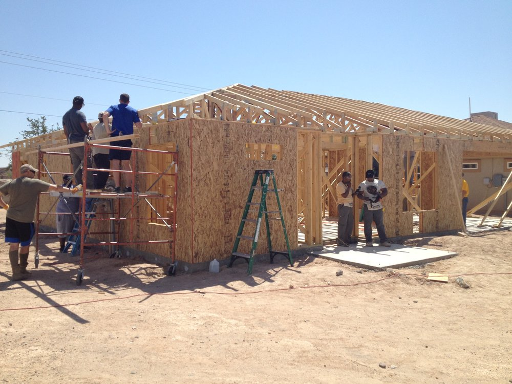 Soldiers from Fort Bliss contribute volunteer hours to a Habitat El Paso house in the northeast, Mesquite Hills Area.