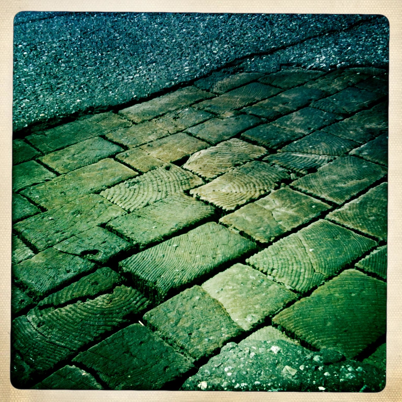 Where the streets are paved with…fir   Not far away in historic Railtown, the asphalt road surface has chipped away to reveal the old wooden cobbles, a century old and still doing their thing.   nr