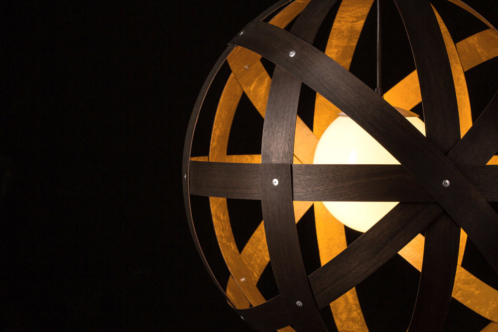 Meridian 24 Pendant Light detail - black stained walnut with gold leaf interior