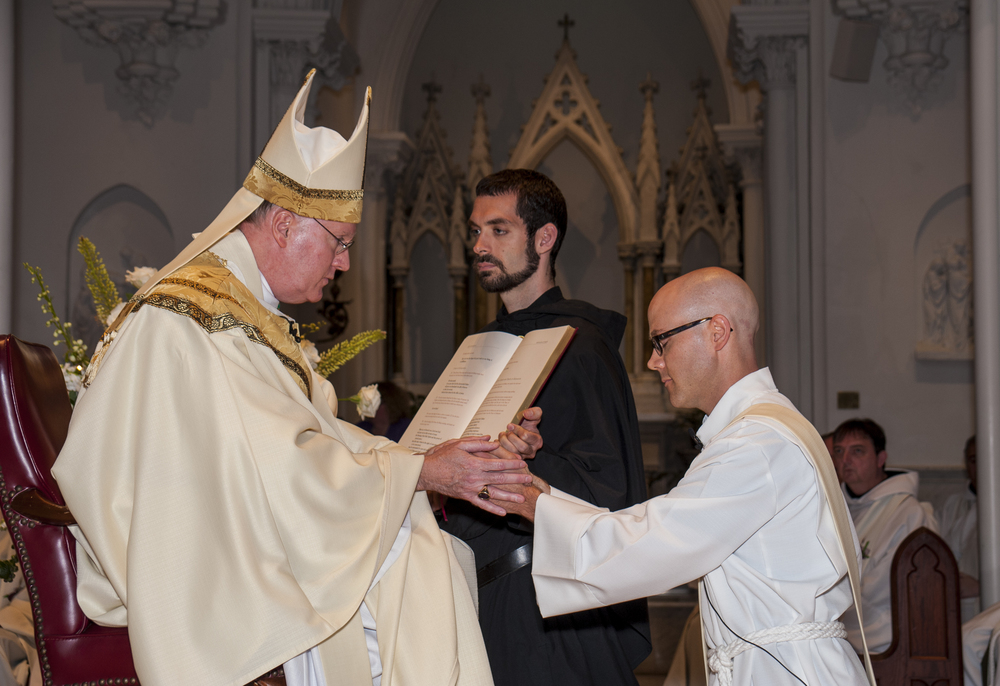 Craig McMahon. O.S.A.., (right) at his ordination by Michael J. Fitzgerald. D.D., Auxiliary Bishop of Philadelphia, In June, 2013.