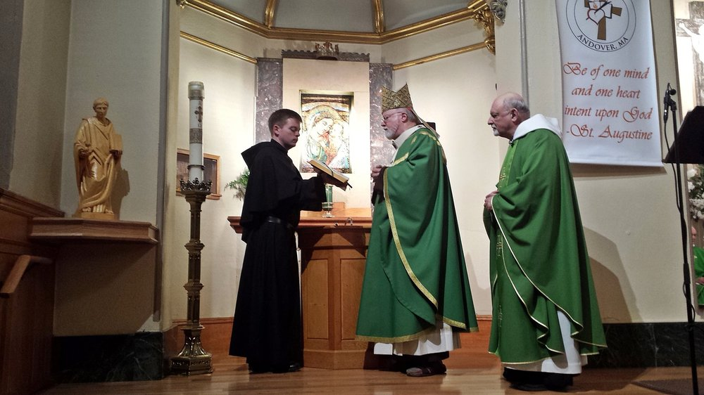 Cardinal O'Malley, OFM Cap., and Prior Provincial Michael Di Gregorio, O.S.A., Bless a Statue of St. Augustine after the 150th Anniversary Mass in Andover, Mass.
