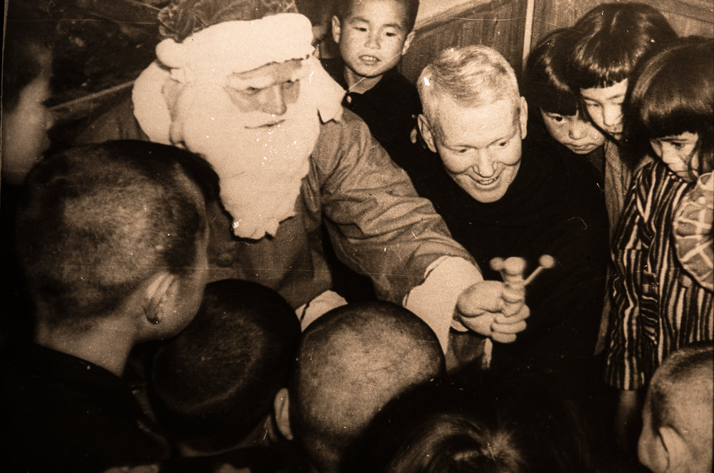 Dec 1955 Father Robinson (Santa) and Father Purcell with children.
