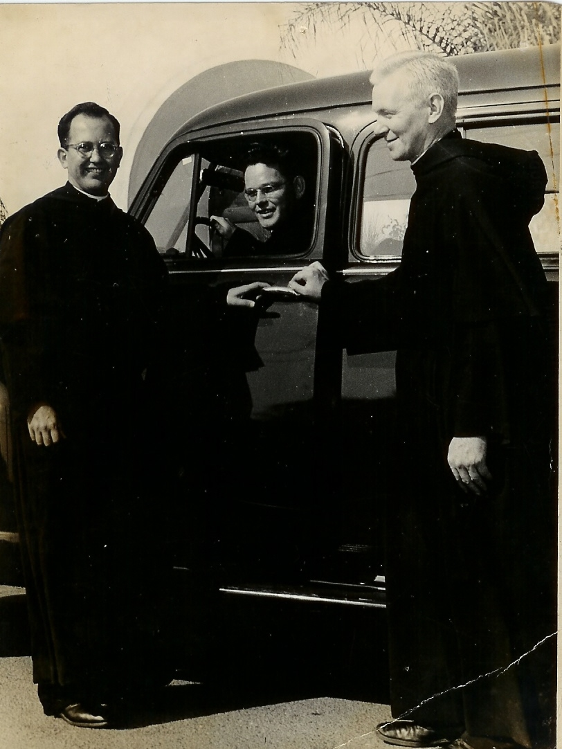 1952 Fathers Krupa, Robinson and Purcell with their car, Saint Rita