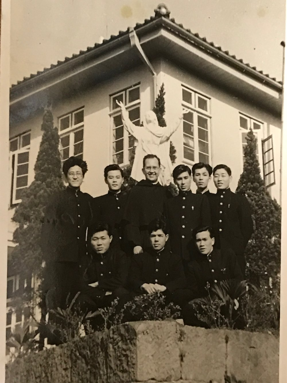 Father Krupa in front of the Hostel on the Nagasaki property that housed college students.