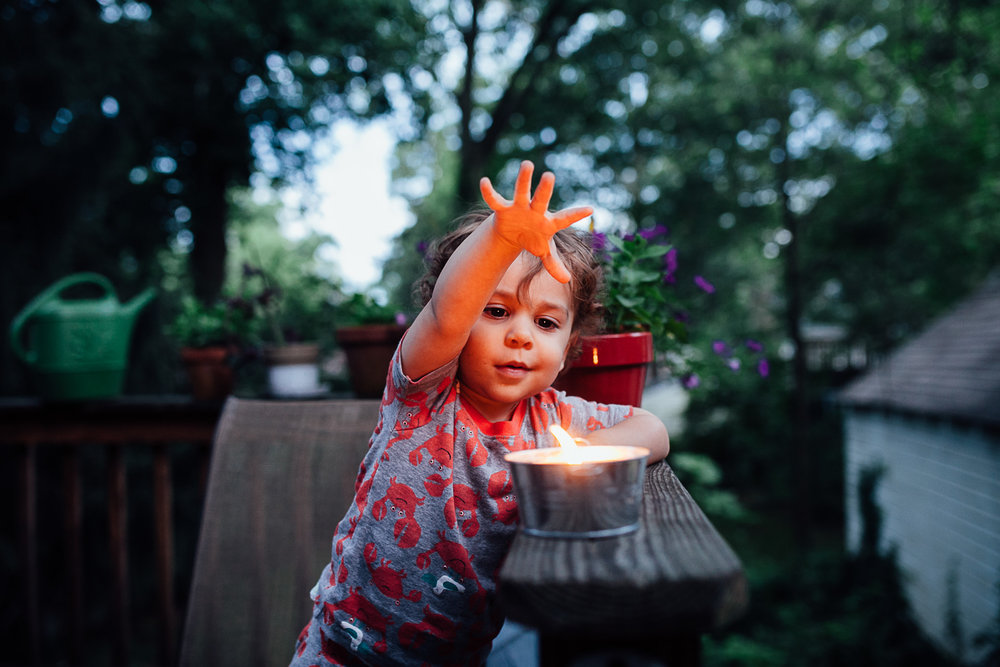boy with candle Juliette Fradin Photography