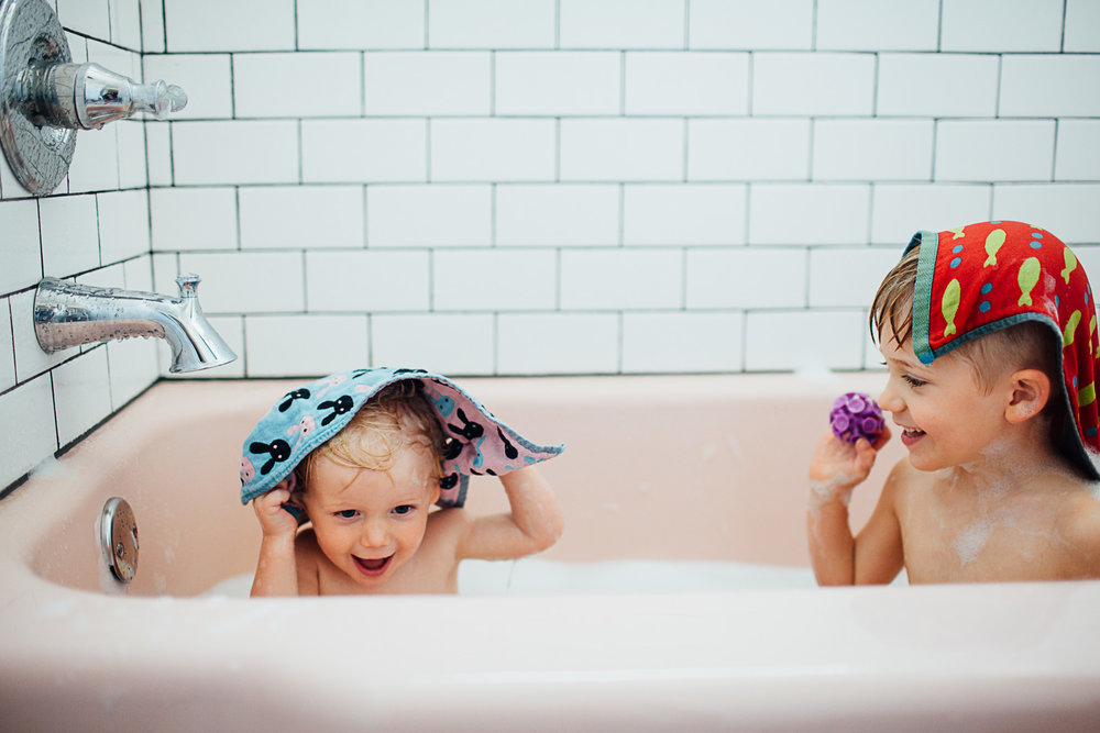 brothers in a pink bath tub by Maryland Documentary photographer Juliette Fradin