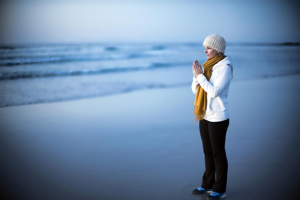 A_namaste_peace_meditation_near_ocean.jpg