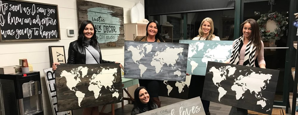 rustic sign painting kelowna world map
