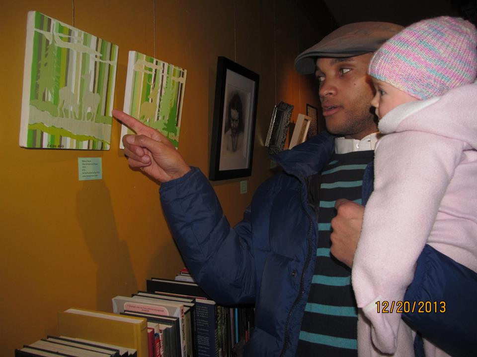 Baby Quinn a budding fan. article: Retrospectives celebrate local arts .  By Joseph and Barrie Ann George, For The Sentinel