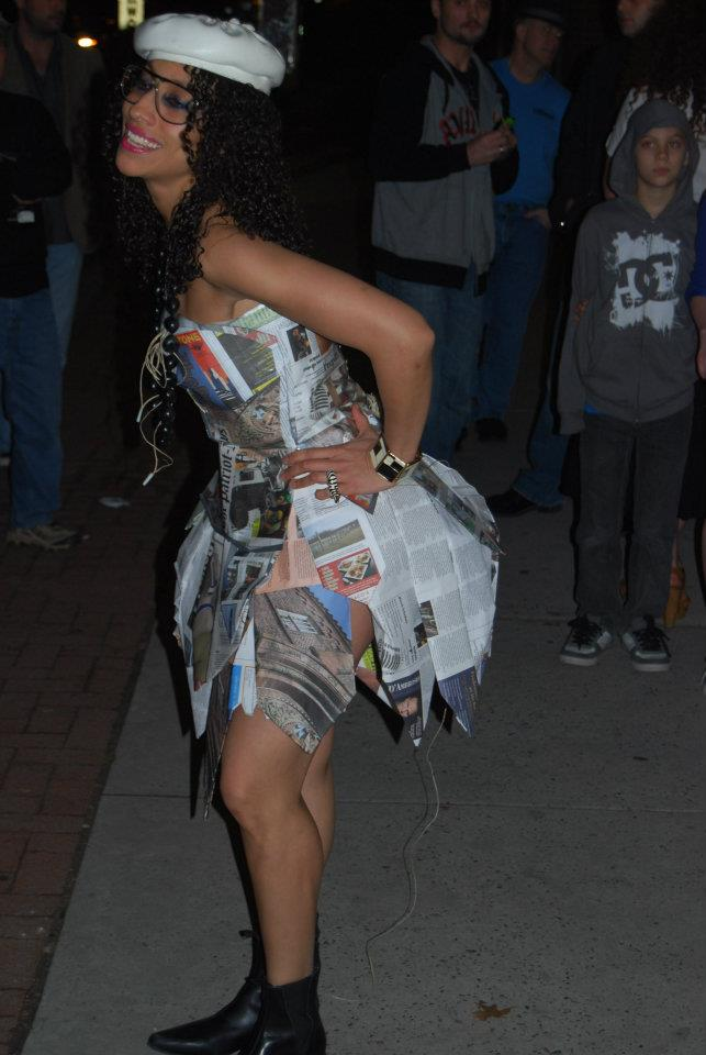 Reina Wooden modeling the newspaper dress for her Opening Night at the Mantis Gallery in Harrisburg, PA. A designer collaboration between Meisa Chase and Jawad Anwar.