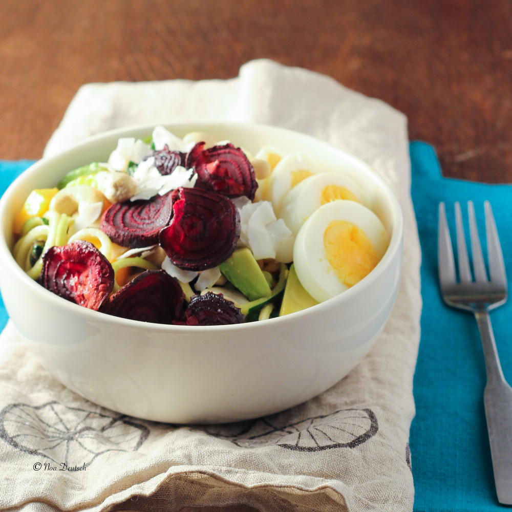 Zucchini noodles with mango, avocado, egg and beet chips