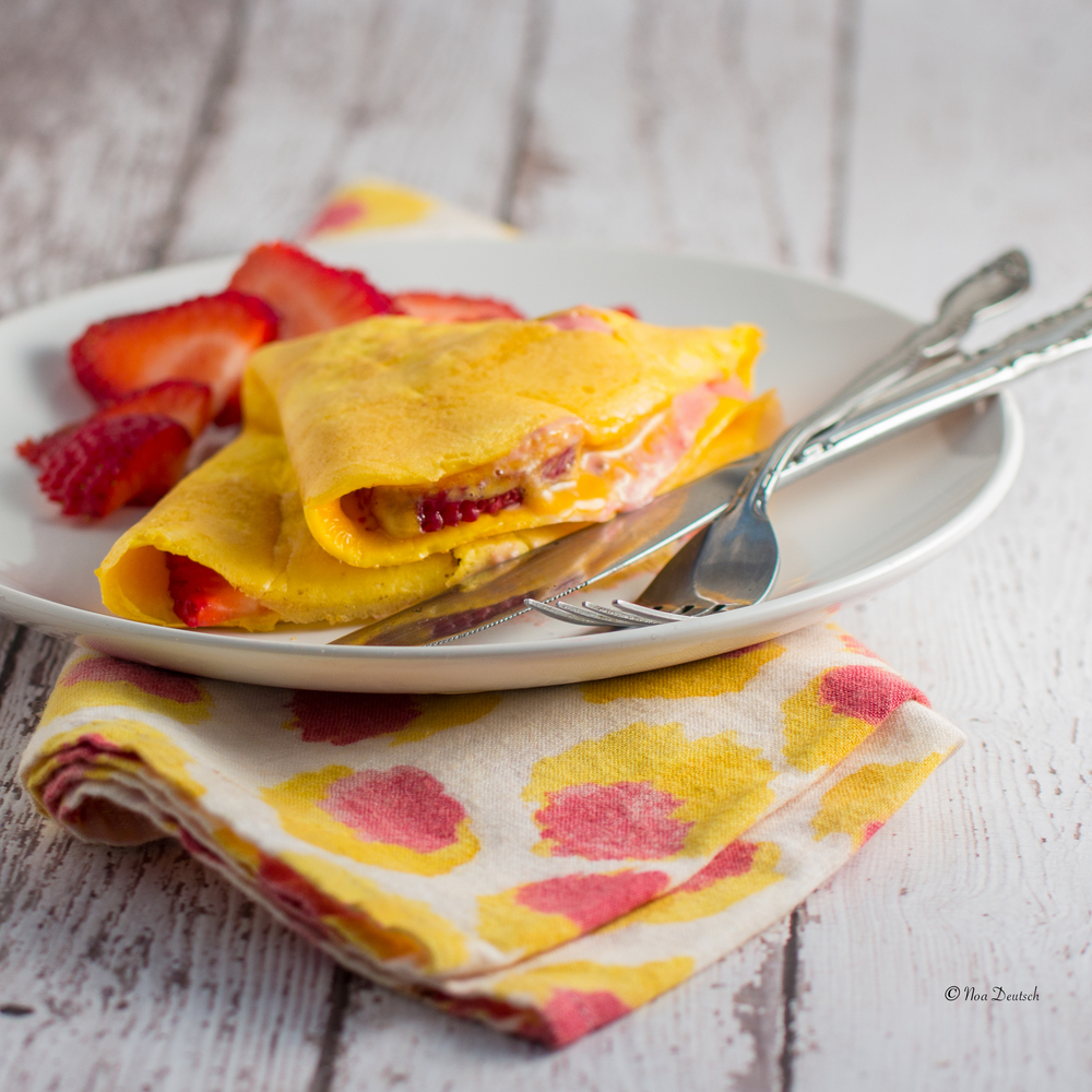 Goat cheese and strawberry stuffed omelette
