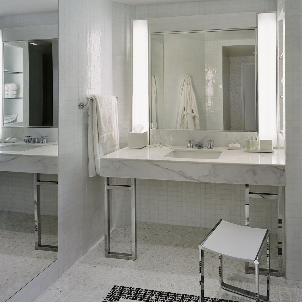 Basin and Dressing vanity. Bathroom comes complete with walk in rain shower and deep bath.
