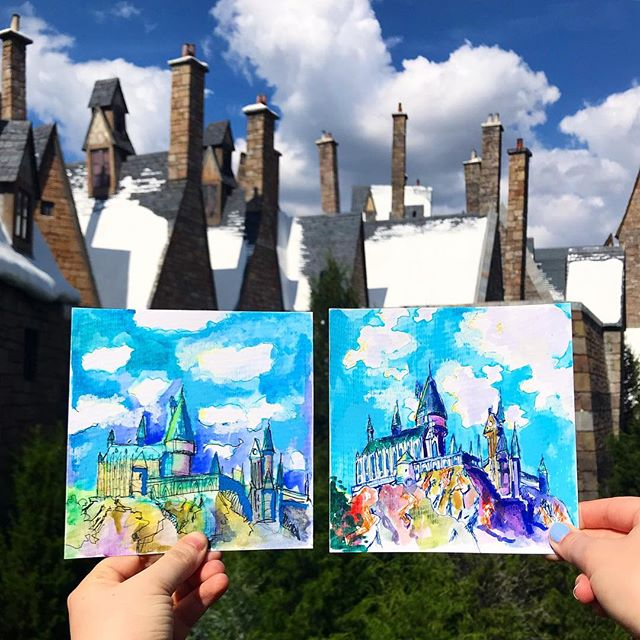 I started the one on the left. He started the one on the right. We drank butterbeer and ate fish and chips and ranked our foot pain from 1 to 10 and laughed and reminisced about our favorite rides (Avatar, Hogwarts Castle, Hulk Rollercoaster 🙋🏼♀️) and scribbled and painted, all while monopolizing a corner booth of The Three Broomsticks. . We swapped the art and then swapped back. We felt the skies needed something, so we made up clouds that ended up manifesting when we went back to take photos. And all of this is why the art-making breaks continue to be my favorite part of any vacation or holiday—and why its always worth it to carry around a semi-heavy bag of art supplies. . 🎨🍺☁️🚂⚡️💜 @prattattackart