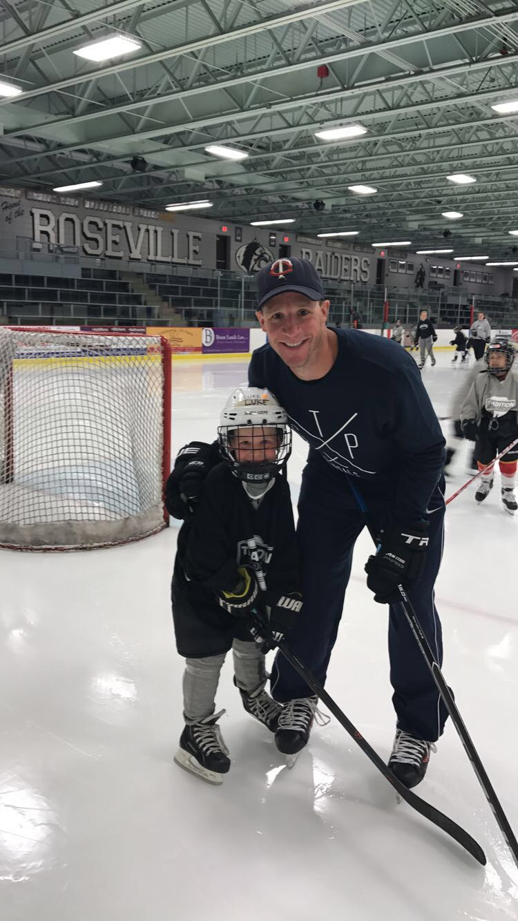 Luke and Andrew at the Tradition Hockey Mite camp run by Carroll family friend, Marty Sertich