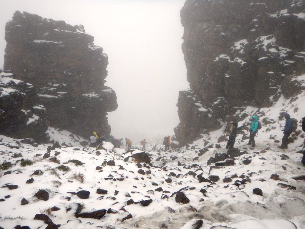 climbing back down from Lava Tower in a wet snow storm