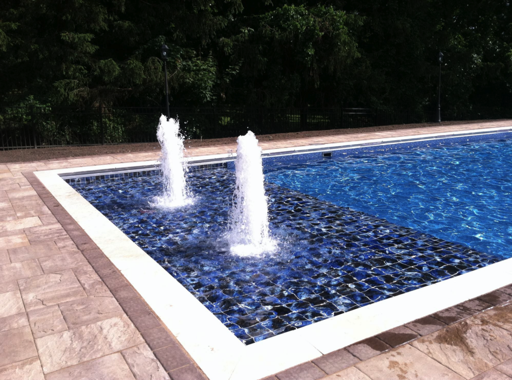 Custom Dutchess County, NY Swimming Pool by Fishkill Pools. Landscaping around the pool by Harmony Hill Landscaping.