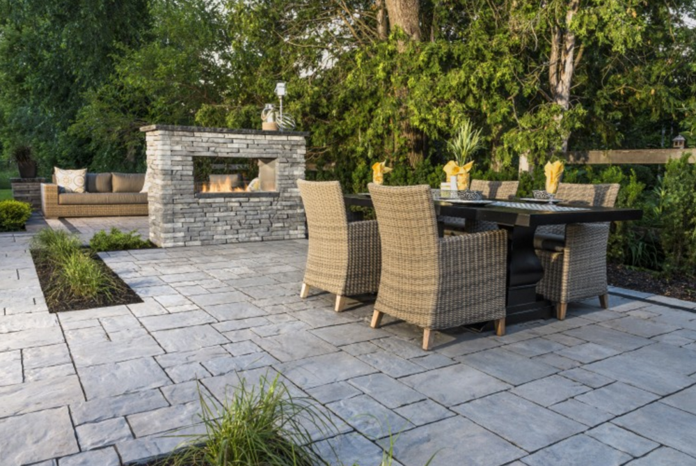 Unilock Thornbury paver patio with Rivercrest retaining wall. Products available for Fishkill, NY patio designs. Photo, Unilock.com.