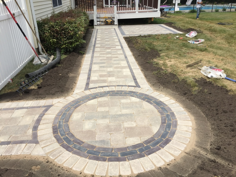 Photos of Custom Unilock Walkway ny Harmony Hill Landscaping during installation in Dutchess County, NY