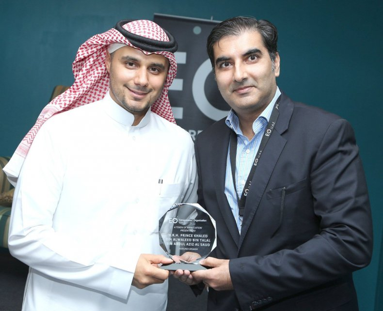 Prince Khaled (left) receives honours from Vikram Shroff, president of the Entrepreneurs' Organization U.A.E. chapter after presenting before members in June 2015. Photo courtesy KBW Investments