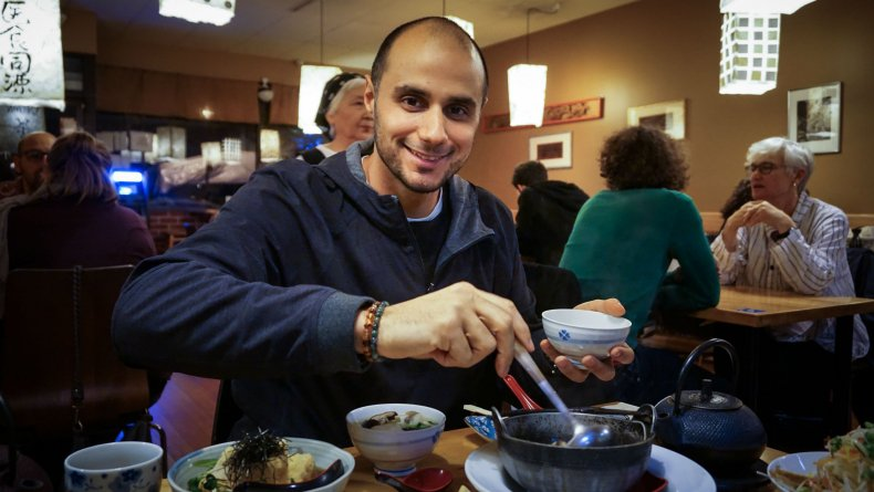 Prince Khaled tucks into the plant-based dishes of Cha-Ya, a vegan Japanese restaurant in San Francisco's bustling Mission District on Wed. Nov. 23, 2016. Photo by Elizabeth McSheffrey