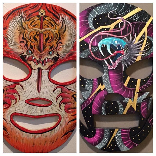 Chris, @killabunzz, was at @zhoubartcenter with his #luchador #masks that he #handpainted for a #gallery in #chicago. Check them out before the #show moves to it #home in #mexico.  #acrylic #paint #acrylicpaint #masks #luchadormask #wrestling #wrestlemania #art #artist #illustrator #illustration #snake #tiger
