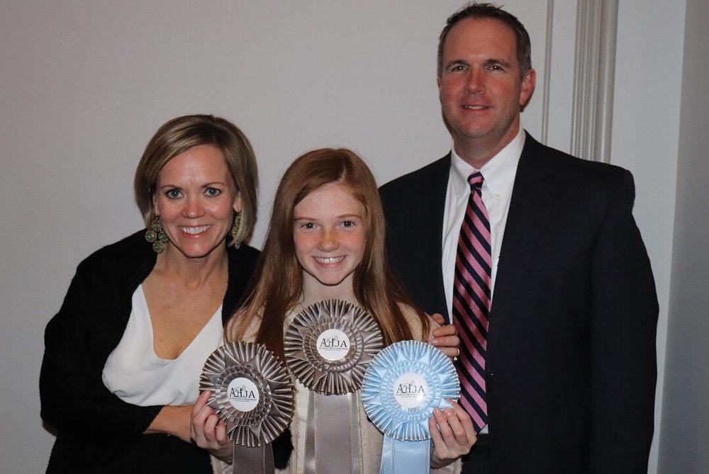 Brynn posing with her Walk Trot awards!
