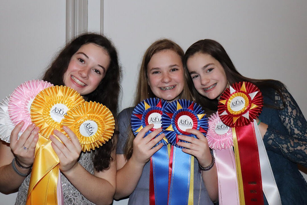 Ribbons galore for Clayton Mullis, Kate Knowles, and Campbell Swanner!