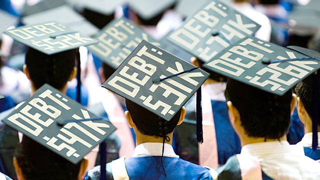 Students display their debt on their graduation caps