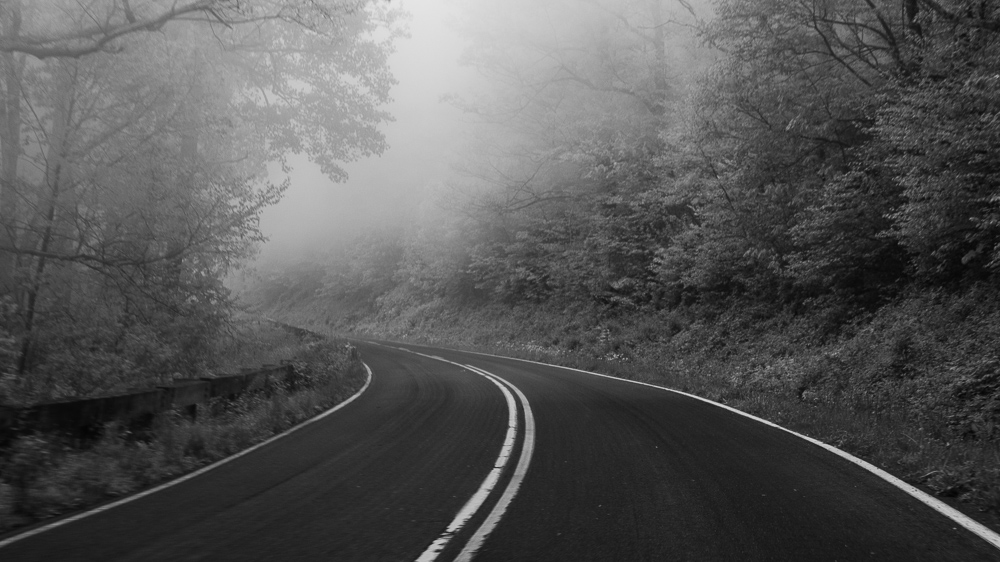 I was riding shotgun so I started taking some photos of the road ahead with the  LX100 .  The fog wasn't quite thick enough to obscure everything at this point.