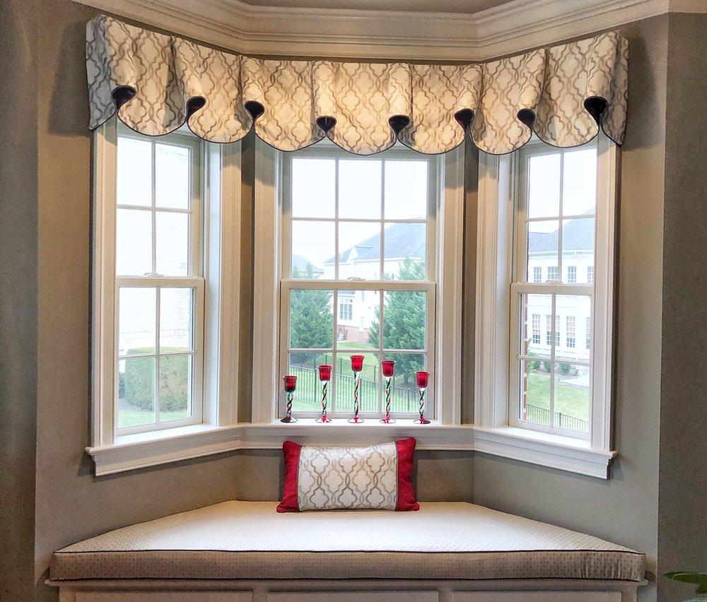Custom valance with shaped bay window cushion.