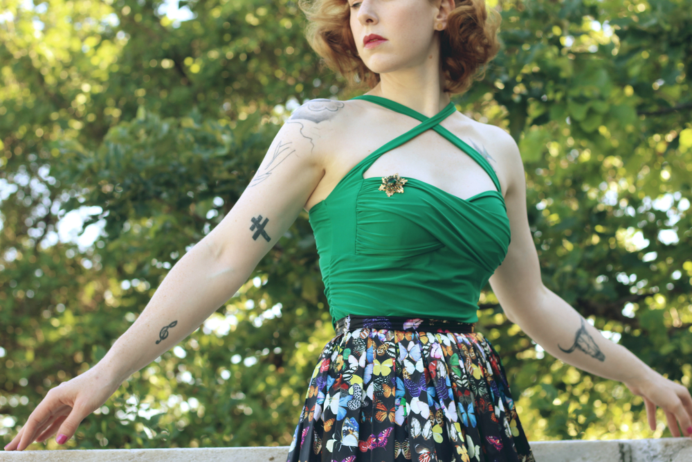 Zella Maybe at the Shedd Aquarium in a butterfly print skirt and green top from the oblong box shop. Pin curls, red hair, 1950s, vintage, retro